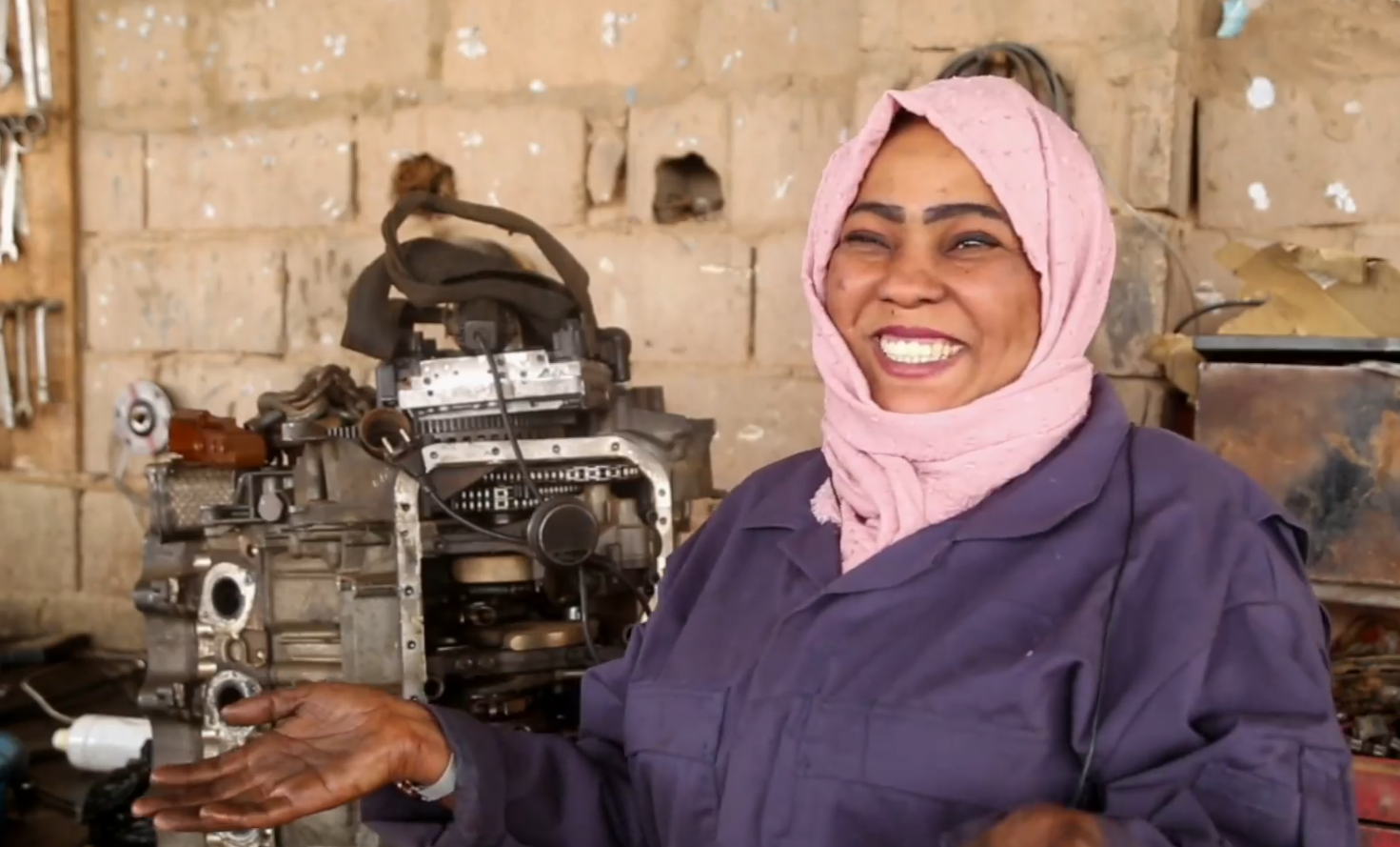 A female car mechanic in the city of Sebha